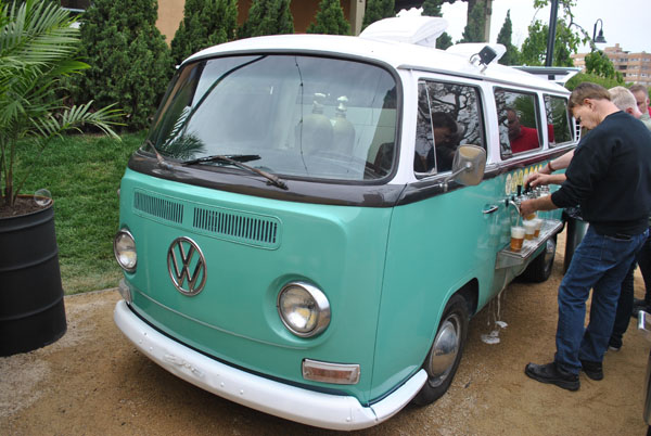 VW bus beer truck in hotel's outdoor beer garden